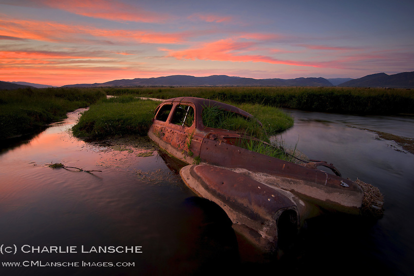Back in the day, farmers and ranchers would sometimes use whatever they could to slow water flow and divert streams for irrigation, including old cars pocked by bullets. As I was packing up my camera equipment tonight, a large trout exploded from the water to the left of this car. Think I'll trade the tripod for the fly rod next time. Summit County, Utah. July 26, 2013.