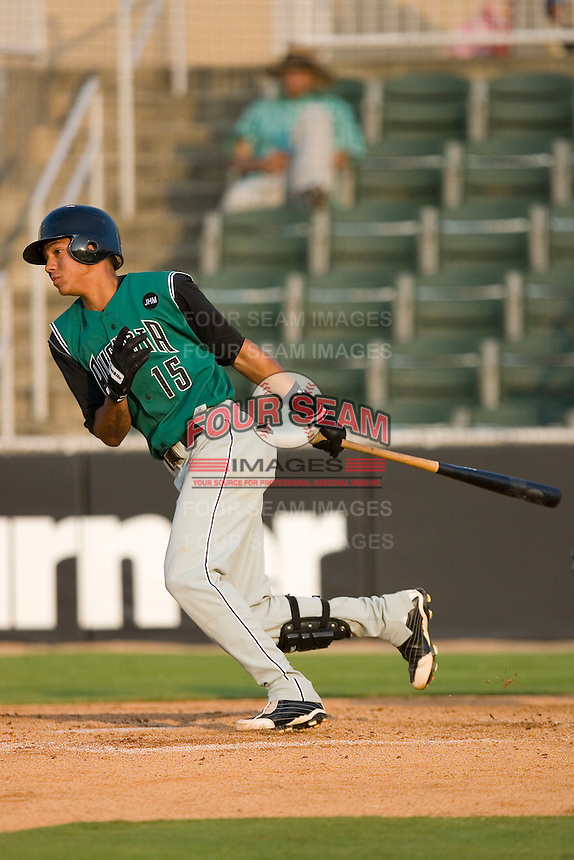 Ehire Adrianza #15 of the Augusta GreenJackets follows through on his swing versus the Kannapolis Intimidators at Fieldcrest Cannon Stadium July 24, 2009 in Kannapolis, North Carolina. (Photo by Brian Westerholt / Four Seam Images)