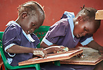 Children draw on chalkboard tablets in a primary school in Bunj, South Sudan, sponsored by Jesuit Relief Service. The community is host to more than 130,000 refugees from the Blue Nile region of Sudan, and JRS provides educational and psycho-social services to both refugees and the host community.