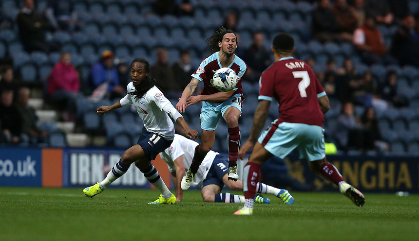 Burnley's George Boyd (centre) and Preston North End's Daniel Johnson (left)<br /> <br /> Photographer Stephen White/CameraSport<br /> <br /> Football - The Football League Sky Bet Championship - Preston North End v Burnley - Friday 22nd April 2016 - Deepdale - Preston <br /> <br /> &copy; CameraSport - 43 Linden Ave. Countesthorpe. Leicester. England. LE8 5PG - Tel: +44 (0) 116 277 4147 - admin@camerasport.com - www.camerasport.com