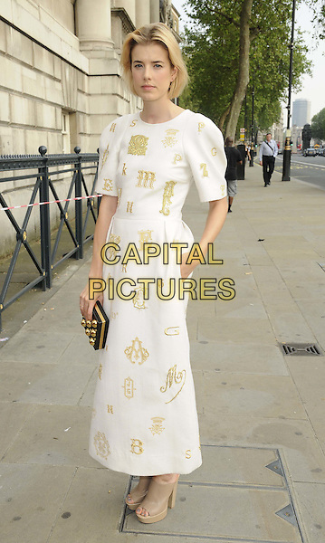 Agyness Deyn  .The NSPCC Pop Art Ball, Banqqueting House, Whitehall, London, England..May 24th, 2012.full length white dress gold print black clutch bag.CAP/CAN.©Can Nguyen/Capital Pictures.
