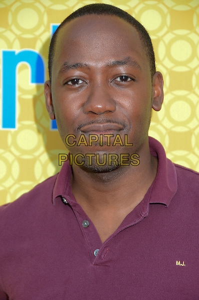 Lamorne Morris.'New Girl' cast at screening and Q&A at Leonard H. Goldenson Theatre, North Hollywood, California, USA..7th May 2012.headshot portrait goatee facial hair purple top.CAP/ADM/BT.©Birdie Thompson/AdMedia/Capital Pictures.