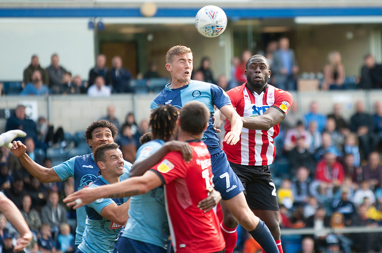 Lincoln City's John Akinde battles with Wycombe Wanderers' David Wheeler<br /> <br /> Photographer Andrew Vaughan/CameraSport<br /> <br /> The EFL Sky Bet League One - Wycombe Wanderers v Lincoln City - Saturday 7th September 2019 - Adams Park - Wycombe<br /> <br /> World Copyright © 2019 CameraSport. All rights reserved. 43 Linden Ave. Countesthorpe. Leicester. England. LE8 5PG - Tel: +44 (0) 116 277 4147 - admin@camerasport.com - www.camerasport.com