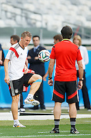 Bastian Schweinsteiger passes the ball to Germany manager Joachim Low