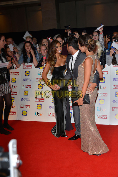 Nicole Scherzinger, Peter Andre and Emily MacDonagh<br /> The Daily Mirror's Pride of Britain Awards arrivals at the Grosvenor House Hotel, London, England.<br /> 7th October 2013<br /> full length dress silver gold sleeveless grey gray suit pregnant couple black clutch bag side profile strapless shaking hands <br /> CAP/PL<br /> &copy;Phil Loftus/Capital Pictures