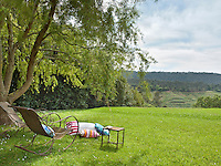 A pair of wrought iron rocking chairs positioned to enjoy the gorgeous panoramic views over the rolling countryside