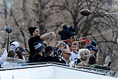 5th February 2019, Boston, Massachusetts, USA;  New England Patriots quarterback Tom Brady (12) tosses a pass to a fan during the New England Patriots Super Bowl Victory Parade on February 5th 2019, through the streets of Boston, Massachusetts.