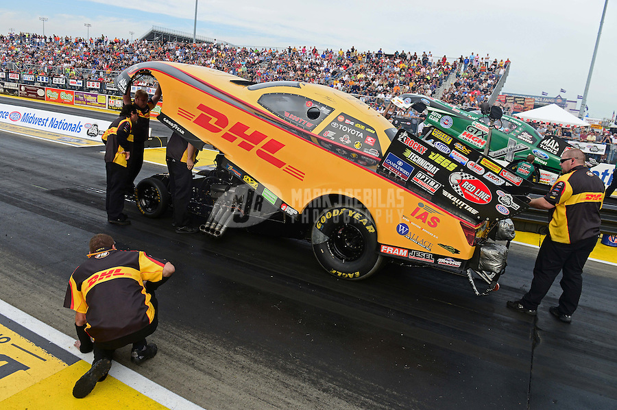 Sept. 28, 2012; Madison, IL, USA: NHRA crew members for funny car driver Jeff Arend during qualifying for the Midwest Nationals at Gateway Motorsports Park. Mandatory Credit: Mark J. Rebilas-