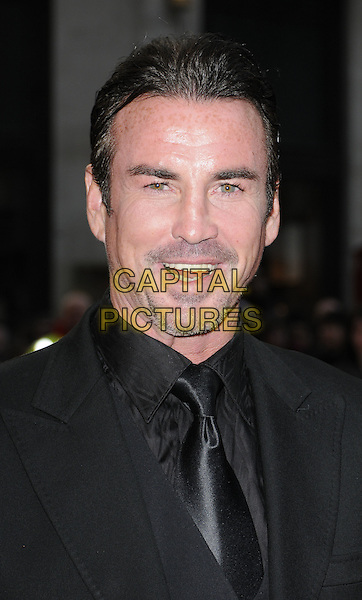 "GARY STRETCH.At the UK film premiere of ""The Heavy"", Odeon West End cinema, Leicester Square, London, England, UK, .April 15th 2010..arrivals portrait headshot smiling mouth open black tie shirt beard stubble goatee facial hair .CAP/CAN.©Can Nguyen/Capital Pictures."