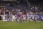 20 March 2008: Honduras players race to the goal in celebration after the game while Guatemala players (background, in all white) collapse to their knees in place. The Honduras U-23 Men's National Team defeated the Guatemala U-23 Men's National Team 6-5 on penalty kicks after a 0-0 overtime tie at LP Field in Nashville,TN in a semifinal game during the 2008 CONCACAF Men's Olympic Qualifying Tournament. With the penalty kick victory, Honduras qualifies for the 2008 Beijing Olympics.