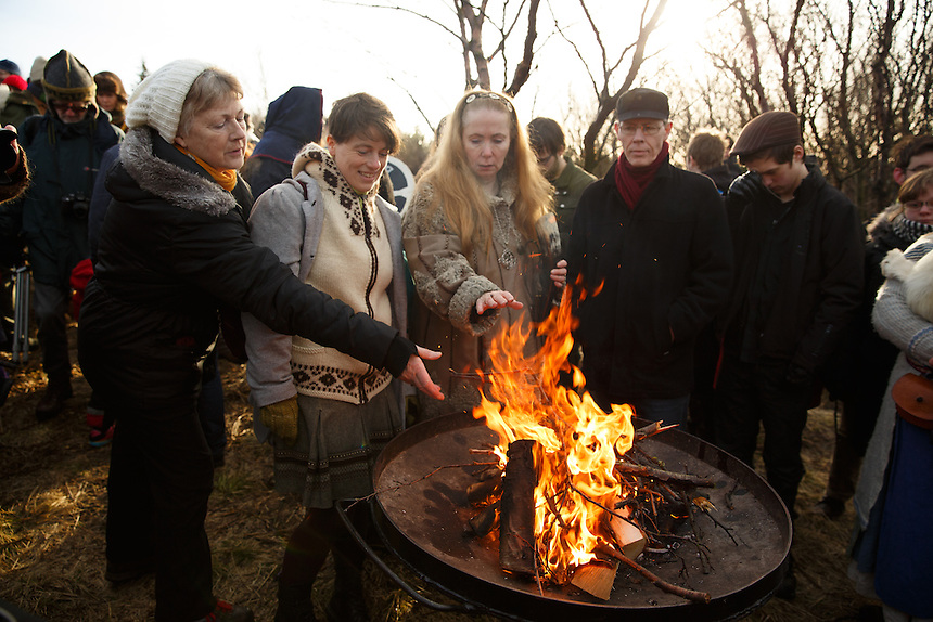 Members of the neo-pagan Asatru association ad kindle to the fire during the turning of the sod ceremony in Reykjavik, Iceland.