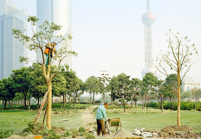 Two men at work in Pudong park in Shanghai