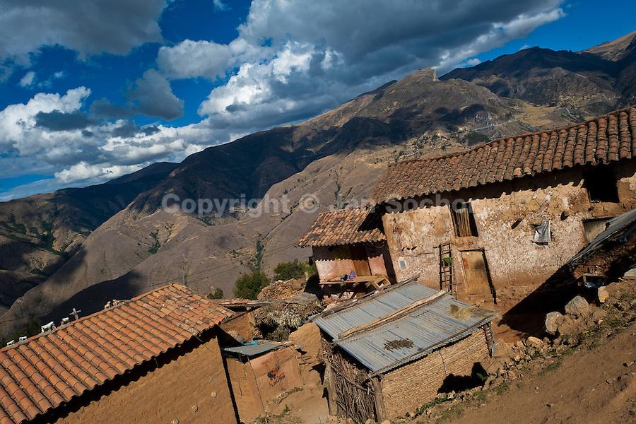 Adobe houses viewed in the mountains of Apurímac, Cotabambas, Peru, 29 July 2012. The Yawar Fiesta (Feast of Blood), an indigenous tradition which dates back to the time of the conquest, consists basically of an extraordinary bullfight in which three protagonists take part - a wild condor, a wild bull and brave young men of the neighboring communities. The captured condor, a sacred bird venerated by the Indians, is tied in the back of the bull which is carefully selected for its strength and pugnacity. A condor symbolizes the native inhabitants of the Andes, while a bull symbolically represents the Spanish invaders. Young boys, chasing the fighting animals, wish to show their courage in front of the community. However, the Indians usually do not allow the animals to fight for a long time because death or harm of the condor is interpreted as a sign of misfortune to the community.