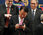 May 6, 2017, Yokohama, Japan -  South Korean Finance Minister Yoo Il-ho checks his smart phone at the photo session of the Board members of Governors of the Asian Development Bank (ADB) at the ADB annual meeting in Yokohama, suburban Tokyo on Saturday, May 6, 2017. ADB has a four-day session for its annual meeting to celebrate the 50th anniversary of the ADB.   (Photo by Yoshio Tsunoda/AFLO) LwX -ytd-