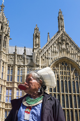 11 June 2014. Kayapo Chief Raoni Metuktire during his visit to London. The chief stands in front of the British Houses of Parliament in Westminster.
