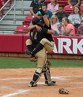 NWA Democrat-Gazette/ANTHONY REYES @NWATONYR<br /> Josie Vaught (21) clings to Jessicca Williams, both of De Queen, in a hug after the final out against Valley View Friday, May 19, 2017 in the 5A State Softball Championship at Bogle Park in Fayetteville. De Queen won 4-1.
