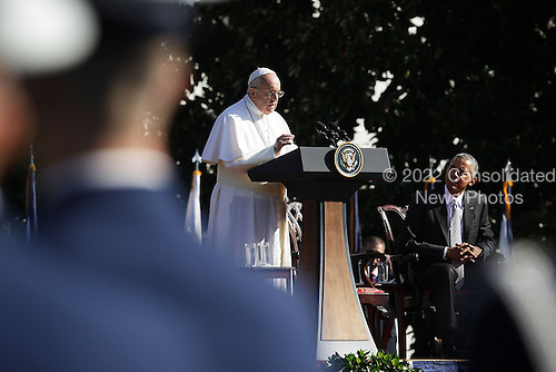 Pope Francis (L) speaks as U.S. President Barack Obama (R) listens during the arrival ceremony at the White House on September 23, 2015 in Washington, DC. The Pope begins his first trip to the United States at the White House followed by a visit to St. Matthew's Cathedral, and will then hold a Mass on the grounds of the Basilica of the National Shrine of the Immaculate Conception.<br /> Credit: Alex Wong / Pool via CNP