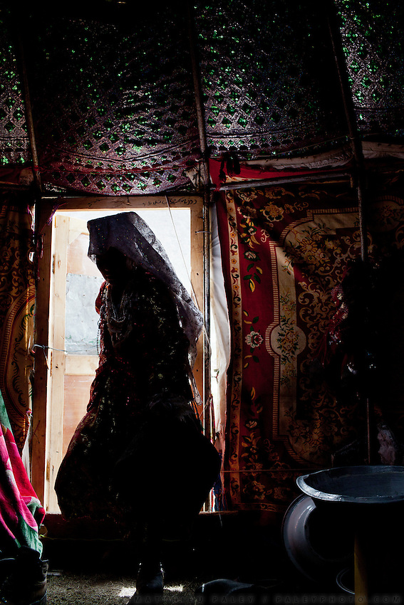 The entrance of a yurt. Daily life at the Khan (chief) summer camp of Kara Jylga...Trekking through the high altitude plateau of the Little Pamir mountains (average 4200 meters) , where the Afghan Kyrgyz community live all year, on the borders of China, Tajikistan and Pakistan.