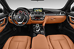 Stock photo of straight dashboard view of 2016 BMW 3 Series Luxury 4 Door Sedan Dashboard