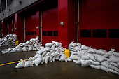 New York, New York.October 30, 2012..Sandbags line the walls of a fires tation in lower Manhattan in hopes of warding off flooding from Hurricane Sandy.