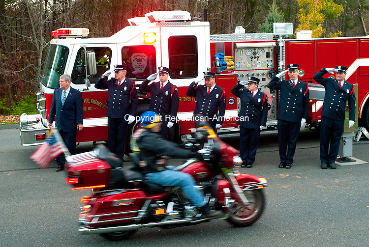 SOUTHBURY, CT, 05 NOVEMBER 2010-111010JS03--Southbury First Selectman Bill Davis and members of the Southbury Volunteer Fire Department salute as members of the Patriot Guard Riders escort United State Air Force soldier Michael Thompson of Southbury back home Wednesday from his service in Afghanistan.<br />  Jim Shannon Republican-American