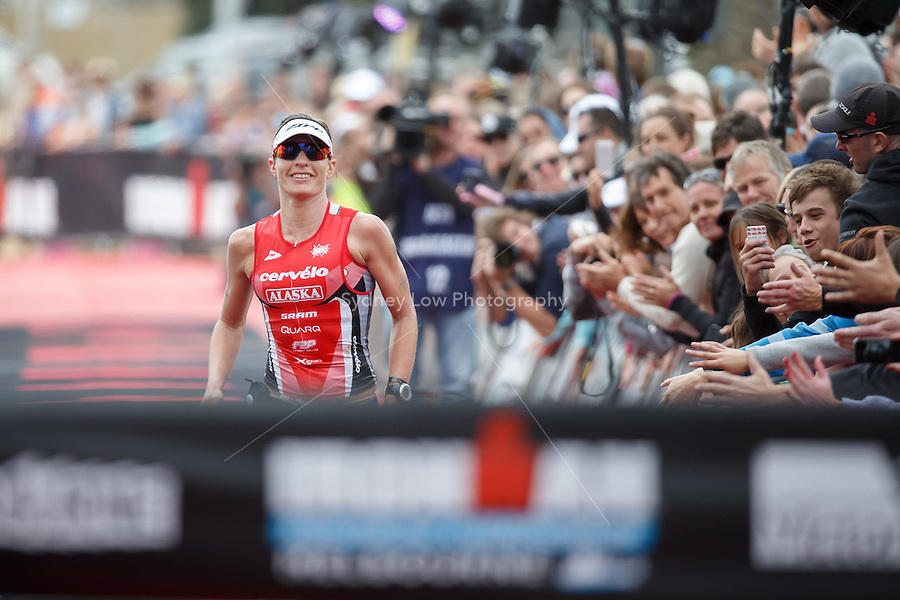 Caroline STEFFEN (SUI) crosses the line and wins the female Pro section of the IRONMAN Asia-Pacific Championship in Melbourne, Australia on Sunday March 23, 2013. (Photo Sydney Low / sydlow.com)