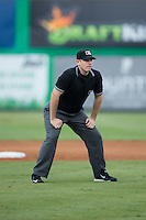 Umpire Russ Weich handles the calls on the bases during the Appalachian League game between the Pulaski Yankees and the Burlington Royals at Burlington Athletic Park on August 6, 2015 in Burlington, North Carolina.  The Royals defeated the Yankees 1-0. (Brian Westerholt/Four Seam Images)