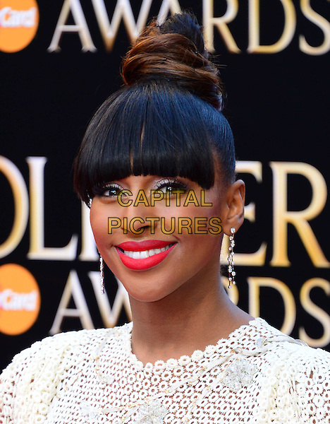 LONDON, ENGLAND - APRIL 13:  Alexandra Burke attends The Olivier Awards, the illustrious ceremony celebrating the very best in English theatre, at Royal Opera House, Covent Garden, on April 13, 2014, in London, England.<br /> CAP/JOR<br /> &copy;Nils Jorgensen/Capital Pictures