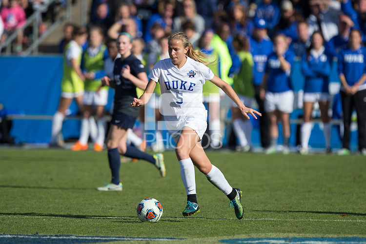 Cary, North Carolina - Sunday December 6, 2015: Rebecca Quinn (5) of the Duke Blue Devils pushes the ball up the field during second half action against the Penn State Nittany Lions at the 2015 NCAA Women's College Cup at WakeMed Soccer Park.  The Nittany Lions defeated the Blue Devils 1-0.