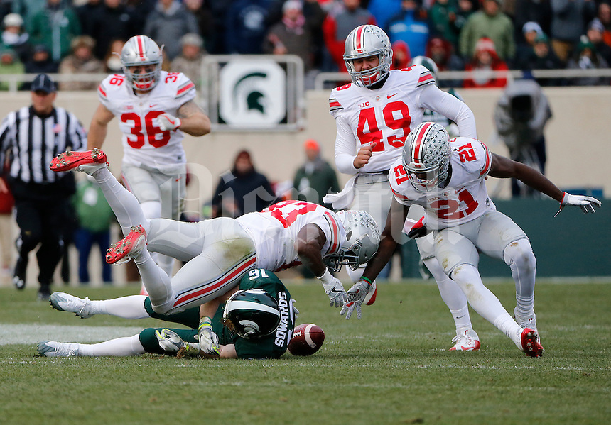 Ohio State Buckeyes wide receiver Terry McLaurin (83) tackles Michigan State Spartans wide receiver Brandon Sowards (16) on a punt return during the fourth quarter of the NCAA football game at Spartan Stadium in East Lansing, Mich. on Nov. 19, 2016. Ohio State won 17-16. (Adam Cairns / The Columbus Dispatch)