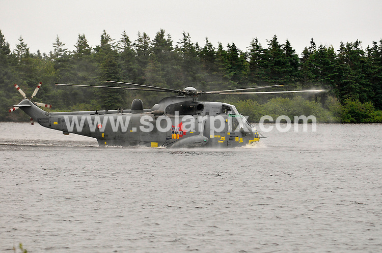 **ALL ROUND PICTURES FROM SOLARPIX.COM**                                             **WORLDWIDE SYNDICATION RIGHTS**                                                                                  Caption: Prince William and Princess Catherine, aka Kate Middleton, The Duke and Duchess of Cambridge, at the Water bird Sea king excersize , Prince Edward Island, during their Royal Tour of Canada. 4 July 2011                                                                              This pic: Prince William and Princess Catherine                                                                                             JOB REF: 13672 MSR       DATE:  04_07_2011                                                          **MUST CREDIT SOLARPIX.COM OR DOUBLE FEE WILL BE CHARGED**                                                                      **MUST AGREE FEE BEFORE ONLINE USAGE**                               **CALL US ON: +34 952 811 768 or LOW RATE FROM UK 0844 617 7637**