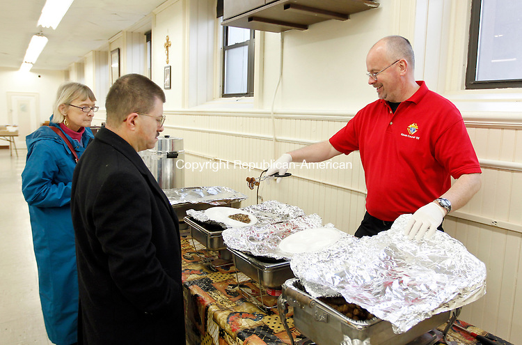 "Naugatuck, CT-25 March 2012-032512CM02-  Knights of Columbus member, David Blasko (right) serves breakfast to Frank Amdrzejak and Mary Mazeiko, both of Naugatuck, during a potato pancake breakfast at St. Mary's Church Sunday morning in Naugatuck. The members of the  Knights of Columbus of Ojeda Council #33 of Naugatuck held the potato pancake breakfast to raise money for local charities.  ""We wanted to generate funds to help out the community."" said Grand Knight, Larry Hanlon.  The Knights plan on holding another pancake breakfast in the near future.   Christopher Massa Republican-American"