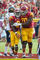 LOS ANGELES, CA - September 22, 2012:  USC wide receiver Marqise Lee (9) celebrates his touchdown with offensive tackle Aundrey Walker (70) during the USC Trojans vs the Cal Bears at the Los Angeles Memorial Coliseum in Los Angeles, CA. Final score USC 27, Cal 9.