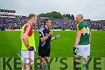 Michael Shields Cork Captain and Kieran Donaghy Kerry Captain with referee Maurice Deegan at the Munster Final at Fitzgerald Stadium, Killarney on Saturday evening.