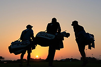 Caddies heading down the 18th hole at sunset during previews ahead of the first round of the NBO Open played at Al Mouj Golf, Muscat, Sultanate of Oman. <br /> 13/02/2018.<br /> Picture: Golffile | Phil Inglis<br /> <br /> <br /> All photo usage must carry mandatory copyright credit (&copy; Golffile | Phil Inglis)