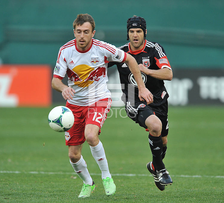 Eric Alexander (12) of The New York Red Bulls controls the ball against Daniel Woolard (21) of D.C. United. The New York Red Bulls defeated D.C. United  2-0, at RFK Stadium, Saturday April 13, 2013.