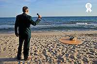 Businessman on beach,  holding Landline Phone (Licence this image exclusively with Getty: http://www.gettyimages.com/detail/83676047 )