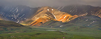 Dramatic light play on mountains in the Polychrome pass region of Denali National park, Alaska