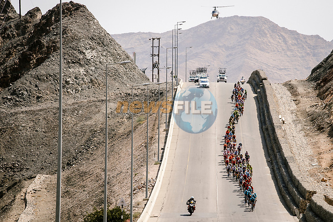 The peloton in action during Stage 4 of 10th Tour of Oman 2019, running 131km from Yiti (Al Sifah) to Oman Convention and Exhibition Centre, Oman. 19th February 2019.<br /> Picture: ASO/P. Ballet | Cyclefile<br /> All photos usage must carry mandatory copyright credit (© Cyclefile | ASO/P. Ballet)