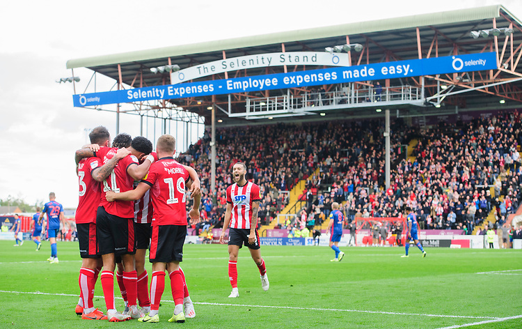 Lincoln City's Tyler Walker celebrates scoring his side's second goal with team-mates<br /> <br /> Photographer Chris Vaughan/CameraSport<br /> <br /> The EFL Sky Bet League One - Lincoln City v Sunderland - Saturday 5th October 2019 - Sincil Bank - Lincoln<br /> <br /> World Copyright © 2019 CameraSport. All rights reserved. 43 Linden Ave. Countesthorpe. Leicester. England. LE8 5PG - Tel: +44 (0) 116 277 4147 - admin@camerasport.com - www.camerasport.com