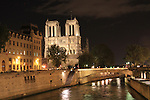 Notre Dame Cathedral at night  along the Seine River, Paris, France.
