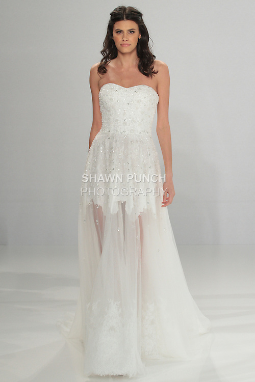 """Model walks runway in Brigid - an A-line embroidered sweetheart dress in tulle, with white incrusted lace, from the Tony Ward Fall 2016 """"A Mid-Summer Night's Dream"""" bridal collection on April 18, 2016 at Kleinfeld Bridal during New York Bridal Fashion Week Spring Summer 2016."""