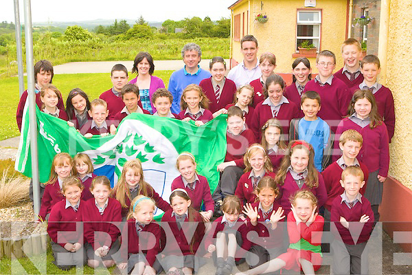 Author Billy Keane presents Lyrecompane NS their Green Flag at their school on Friday