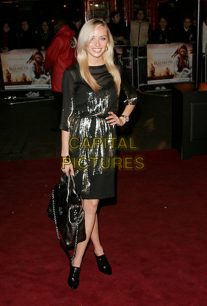 "NOELLE RENO.UK Premiere of ""Elizabeth - The Golden Age"" at the Odeon Leicester Square, London, England, October 23rd 2007..full length black gold metallic shiny dress bag shoes boots hand on hip.CAP/AH.©Adam Houghton/Capital Pictures."