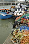 Boats and fishing nets at Whitstable Harbour, Kent, England