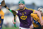Harry Kehoe of Wexford in action against Ryan Taylor of Clare during the Jack Lynch Memorial game at Tulla. Photograph by John Kelly.