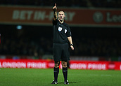 2nd December 2017, Griffen Park, Brentford, London; EFL Championship football, Brentford versus Fulham; Referee Robert Madley in action