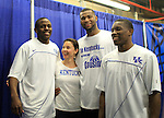Ashley Judd pulls Darius Miller, DeMarcus Cousins and Eric Bledsoe together for a picture after the UK men's basketball 90-60 win over Wake Forest for the second round of the NCAA tournament at New Orleans Arena on Saturday, March 20, 2010. Photo by Adam Wolffbrandt | Staff
