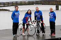 Photo: Richard Lane/Richard Lane Photography. GE Strathclyde Park Triathlon Media Event. 30/03/2011. Last year's elite women's winner, Jacqueline Slack and triathlonscotland coach of the year, Gordon Crawford demonstrate transition at the launch the event.