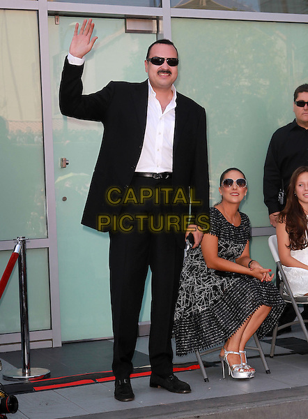 Pepe Aguilar & Anelisse Aguilar.Latin Singer Pepe Aguilar Honored With Star Held On The Hollywood Walk Of Fame, Hollywood, California, USA..July 26th, 2012.full length  black grey gray dress sitting sunglasses shades silver platform sandals shoes suit shirt hand arm waving .CAP/ADM/KB.©Kevan Brooks/AdMedia/Capital Pictures.